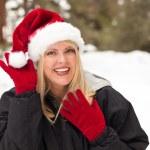 Attractive Santa Hat Wearing Blond Woman Having Fun in Snow — Stock Photo
