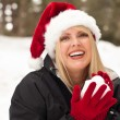 Attractive Santa Hat Wearing Blond Woman Having Fun in Snow — Stock Photo