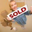 Womand Doggy with Sold Sign Near Moving Boxes — Stock Photo #4783051