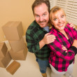Proud Goofy Couple and Moving Boxes in Empty Room — Stock Photo
