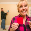 Couple Comparing Paint Colors in Empty Room — Stock Photo #4783080