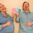 Pregnant Laughing Couple Deciding on Pink of Blue Wall Paint — Stock Photo