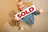 Woman and Doggy with Sold Sign Near Moving Boxes — Stock Photo