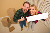 Goofy Goofy Thumbs Up Couple Holding Blank Sign Surrounded by Bo — Stock Photo