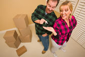 Goofy Excited Man Handing Keys to Smiling Wife — Stock Photo