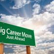 Royalty-Free Stock Photo: Big Career Move Green Road Sign and Clouds