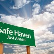 Safe Haven Green Road Sign and Clouds — Stock Photo #4975026