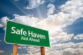 Safe Haven Green Road Sign and Clouds — Stock Photo