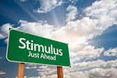 Stimulus Green Road Sign and Clouds — Stock Photo