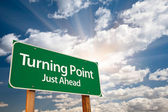 Turning Point Green Road Sign and Clouds — Stock Photo