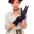 Red Haired Female Detective Putting on Gloves Wearing a Trenchco — Stock Photo