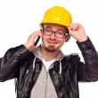 Handsome Young Man in Hard Hat on Phone - Stock Photo