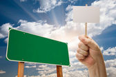 Blank Green Road Sign and Man Holding Poster on Stick — Stock Photo