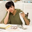 Multi-ethnic Young Woman Agonizing Over Financial Calculations — Stock Photo #5078920