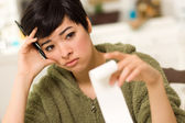 Multi-ethnic Young Woman Agonizing Over Financial Calculations — Stock Photo