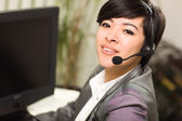 Attractive Young Mixed Race Woman Smiles Wearing Headset — Stock Photo