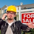 Stock Photo: Contractor in Hard Hat in Front of House and Real Estate Sign