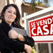 Stock Photo: Female Hispanic Real Estate Agent, Se Vende Casa Sign and House
