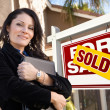 Female Hispanic Real Estate Agent, Sold For Sale Real Esate Sign — Stock Photo #5164134