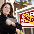 Female Hispanic Real Estate Agent, Sold For Sale Real Esate Sign — Stock Photo
