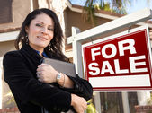 Female Hispanic Real Estate Agent, For Sale Real Esate Sign and — Stock Photo