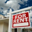 For Rent Real Estate Sign in Front of House - Stock Photo