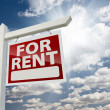 Right Facing For Rent Real Estate Sign Over Sunny Sky - Stock Photo