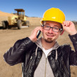 Young Construction Worker on Cell Phone in Dirt Field with Tract — Stock Photo