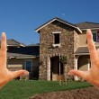 Female Hands Framing Beautiful House - Stock Photo