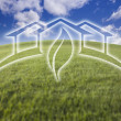 Green House Ghosted Over Fresh Grass and Sky - Stock Photo