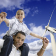 Happy Hispanic Father and Son with Wind Turbine — Stockfoto