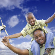 Happy African American Father and Son with Wind Turbine — Stock Photo