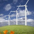 Wind Turbines Against Dramatic Sky and California Poppies - Stock Photo