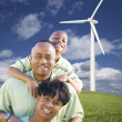 Happy African American Family and Wind Turbine — Stock Photo #5259721