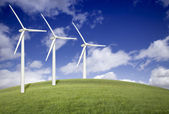 Three Wind Turbines Over Grass Field and Blue Sky — Foto de Stock