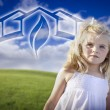 Adorable Blue Eyed Girl Playing Outside with Ghosted Green House - Stockfoto