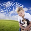 Boy and His Dog Playing Outside with Ghosted Green House Graphic - Stock Photo