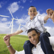Happy Hispanic Father and Son with Wind Turbine — Stok fotoğraf