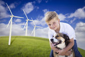 Young Boy and Dog in Wind Turbine Field — Stock Photo