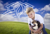 Boy and His Dog Playing Outside with Ghosted Green House Graphic — Stock Photo