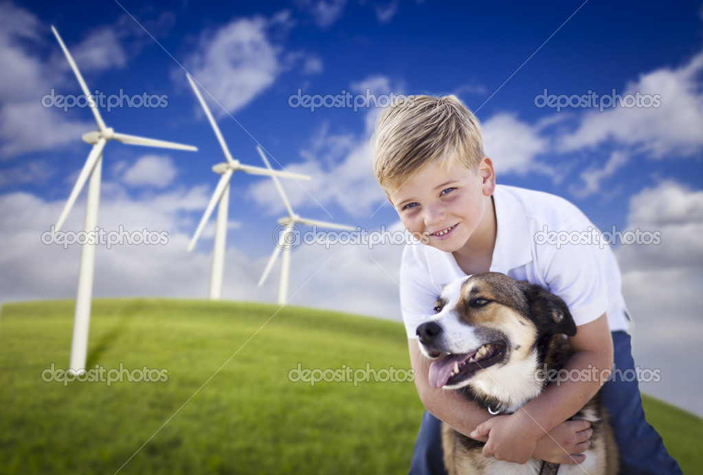 Handsome Young Blue Eyed Boy and Dog Playing Near Wind Turbines and Grass Field. — Stock Photo #5271008