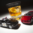 Police and Sports Car Next to Alcoholic Drink - Stock Photo