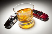Police and Sports Car Next to Alcoholic Drink with Ice — Stock Photo