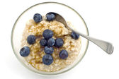 Oatmeal with blueberries — Stock Photo