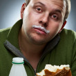 Portrait of funny man with bread and bottle. Yogurt traces on hi — Stock Photo #3930686