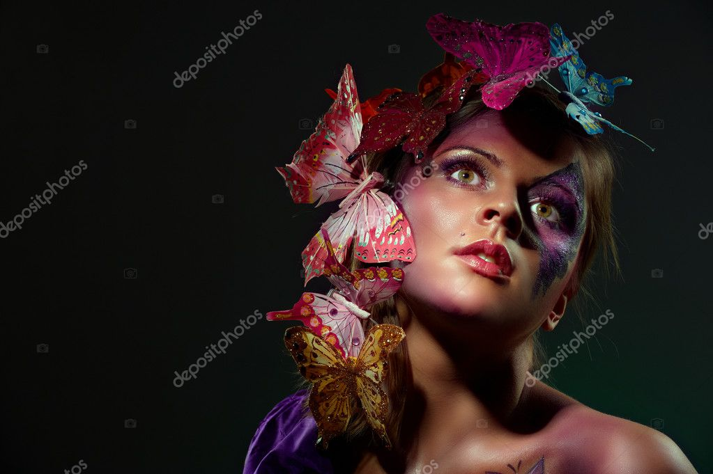 Colorful fashion portrait of attractive young beauty with butterflies in hairs  Stock Photo #3951725