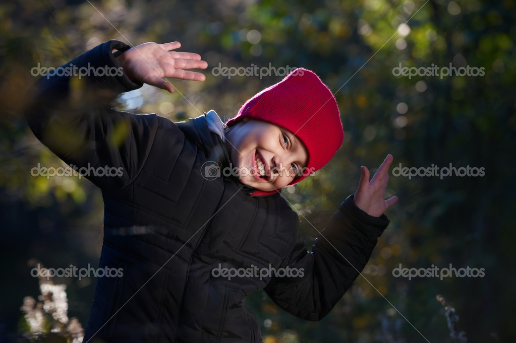 Outdoor portrait of cheerful little girl — Stock Photo #3975690