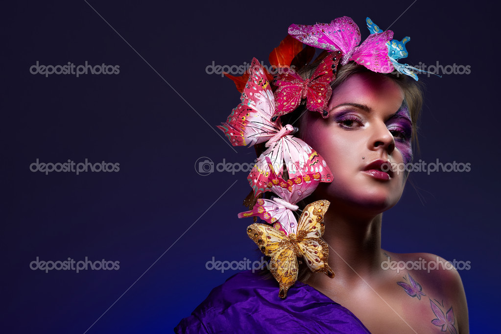 Colorful fashion portrait of attractive young beauty with butterflies in hairs — Stock Photo #3978661