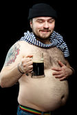 Drunk sailor man with mug of dark beer — Stock Photo