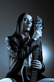 Portrait of musician with bass guitar — Stock Photo